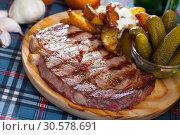 Купить «Fried beef steak», фото № 30578691, снято 9 июня 2019 г. (c) Яков Филимонов / Фотобанк Лори