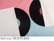 Купить «Music records on pink and blue wooden background. Retro music concept», фото № 30579603, снято 12 апреля 2019 г. (c) Майя Крученкова / Фотобанк Лори