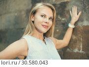 Купить «female standing near the stone wall», фото № 30580043, снято 29 июля 2017 г. (c) Яков Филимонов / Фотобанк Лори