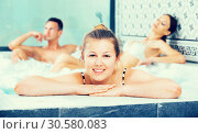 Купить «Three friends relaxing enjoying jacuzzi hot tub bubble bath», фото № 30580083, снято 12 июня 2017 г. (c) Яков Филимонов / Фотобанк Лори