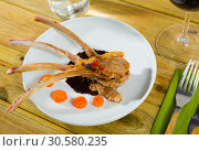 Купить «Roasted rack of mutton with berry sauce and carrot», фото № 30580235, снято 22 мая 2019 г. (c) Яков Филимонов / Фотобанк Лори