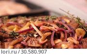 Купить «pieces tenderloin of raw beef meat marinated with onion, garlic and rosemary are lying in black tray on the store shelf in slow mo close up camera motion 4K video with no people», видеоролик № 30580907, снято 5 ноября 2018 г. (c) Uladzimir Sitkouski / Фотобанк Лори