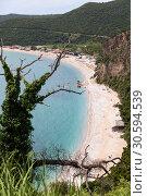 Купить «Сухое дерево на горе, вид на пляж Jaz и Адриатическое море. Курорт на окраине Будвы, Черногория, Балканы, Европа», фото № 30594539, снято 3 июня 2016 г. (c) Кекяляйнен Андрей / Фотобанк Лори