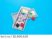 Купить «Playing Dices and Stack of American Dollars Bills», фото № 30600635, снято 18 апреля 2019 г. (c) Pavel Biryukov / Фотобанк Лори