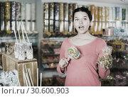 Купить «girl buying candies at shop», фото № 30600903, снято 22 марта 2017 г. (c) Яков Филимонов / Фотобанк Лори