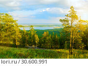 Купить «Forest landscape with trees, mountain slopes and lake under soft sunset light», фото № 30600991, снято 23 августа 2013 г. (c) Зезелина Марина / Фотобанк Лори