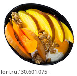 Купить «Breakfast with pumpkin and mango served with whipped topping and oat flakes», фото № 30601075, снято 21 апреля 2019 г. (c) Яков Филимонов / Фотобанк Лори