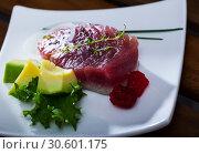 Купить «Slightly fried tuna with avocado, greens», фото № 30601175, снято 20 апреля 2019 г. (c) Яков Филимонов / Фотобанк Лори