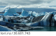 Купить «Lagoon Jokulsarlon, glacial lake and icebergs», фото № 30601743, снято 21 июля 2011 г. (c) Сергей Майоров / Фотобанк Лори