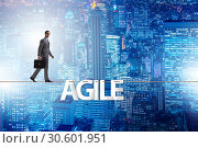 Купить «Agile transformation concept with businessman walking on tight r», фото № 30601951, снято 2 июня 2020 г. (c) Elnur / Фотобанк Лори
