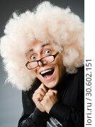 Купить «Young man wearing afro wig», фото № 30602151, снято 15 июня 2014 г. (c) Elnur / Фотобанк Лори