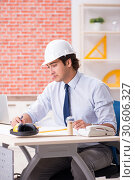 Купить «Construction supervisor working on blueprints», фото № 30606327, снято 13 сентября 2018 г. (c) Elnur / Фотобанк Лори