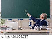 Купить «Aged male teacher in front of chalkboard», фото № 30606727, снято 20 декабря 2018 г. (c) Elnur / Фотобанк Лори