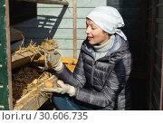 Купить «Young woman holding fresh eggs in a chicken coop», фото № 30606735, снято 18 марта 2019 г. (c) Яков Филимонов / Фотобанк Лори