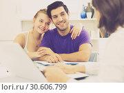 Купить «Young couple with real estate agent at home», фото № 30606799, снято 18 января 2020 г. (c) Яков Филимонов / Фотобанк Лори