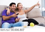 Купить «Loving couple on sofa watching TV», фото № 30606807, снято 22 сентября 2019 г. (c) Яков Филимонов / Фотобанк Лори
