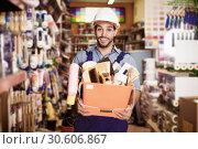 Купить «foreman holding basket with tools», фото № 30606867, снято 13 сентября 2017 г. (c) Яков Филимонов / Фотобанк Лори