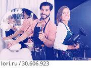 Купить «Smiling male makeup artist and woman hairdresser», фото № 30606923, снято 22 августа 2019 г. (c) Яков Филимонов / Фотобанк Лори
