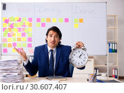 Купить «Young handsome employee in front of whiteboard with to-do list», фото № 30607407, снято 16 октября 2018 г. (c) Elnur / Фотобанк Лори