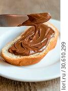 Купить «Slice of bread with chocolate cream», фото № 30610299, снято 28 июля 2013 г. (c) easy Fotostock / Фотобанк Лори
