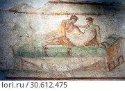 Купить «ITALY, POMPEII- SEPTEMBER 21, 2010: murals, paintings on the walls in the ruins of Pompeii», фото № 30612475, снято 21 сентября 2010 г. (c) Куликов Константин / Фотобанк Лори