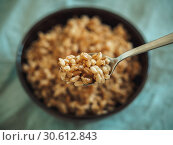 boiled spelt in spoon, selective focus. Стоковое фото, фотограф Ольга Сергеева / Фотобанк Лори