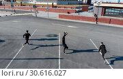 Three athletic young men running on the road. Aerial view. Стоковое фото, фотограф Константин Шишкин / Фотобанк Лори