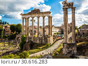Купить «Roman forum, with the temple of Vespasian and Titus and temple of Saturn in the foreground. Rome, Italy», фото № 30616283, снято 14 сентября 2017 г. (c) Наталья Волкова / Фотобанк Лори