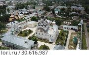 Купить «Aerial view of Russian city of Murom along bank of Oka River with Trinity convent and Annunciation Monastery», видеоролик № 30616987, снято 27 июня 2018 г. (c) Яков Филимонов / Фотобанк Лори