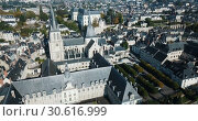 Купить «View from drone of Medieval Eglise Saint-Nicolas, St. Nicolas church, built in 12th century in Blois, France», видеоролик № 30616999, снято 25 октября 2018 г. (c) Яков Филимонов / Фотобанк Лори