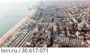 Купить «Aerial panoramic view of modern cityscape of Badalona in sunny day, Spain», видеоролик № 30617071, снято 19 января 2019 г. (c) Яков Филимонов / Фотобанк Лори