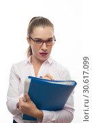 Купить «Charming young woman with eyeglasses and folders», фото № 30617099, снято 19 октября 2017 г. (c) Pavel Biryukov / Фотобанк Лори