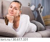 Купить «Young smiling woman posing easily with good mood in free time», фото № 30617331, снято 26 августа 2019 г. (c) Яков Филимонов / Фотобанк Лори