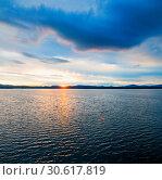 Купить «Sea sunset landscape. Sea water surface lit by sunset light. Summer sunny water scene in colorful tones», фото № 30617819, снято 26 августа 2013 г. (c) Зезелина Марина / Фотобанк Лори