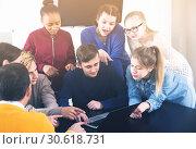 Купить «happy classmates having difficult project to complete during class», фото № 30618731, снято 28 февраля 2017 г. (c) Яков Филимонов / Фотобанк Лори