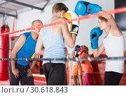 Купить «Teenagers sportsmans exercising at boxing with coach», фото № 30618843, снято 12 апреля 2017 г. (c) Яков Филимонов / Фотобанк Лори