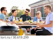 Купить «happy friends having bbq party on rooftop», фото № 30619299, снято 2 сентября 2018 г. (c) Syda Productions / Фотобанк Лори