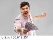 Купить «happy young man with fan of euro money», фото № 30619351, снято 3 февраля 2019 г. (c) Syda Productions / Фотобанк Лори
