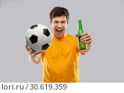 Купить «man or football fan with soccer ball and beer», фото № 30619359, снято 3 февраля 2019 г. (c) Syda Productions / Фотобанк Лори