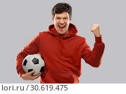 Купить «happy man or football fan with soccer ball winning», фото № 30619475, снято 3 февраля 2019 г. (c) Syda Productions / Фотобанк Лори