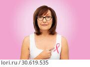 Купить «old woman with pink breast cancer awareness ribbon», фото № 30619535, снято 8 февраля 2019 г. (c) Syda Productions / Фотобанк Лори