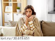 Купить «sad sick woman in blanket and scarf at home», фото № 30619651, снято 6 марта 2019 г. (c) Syda Productions / Фотобанк Лори
