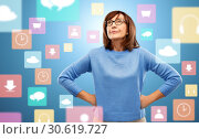 Купить «displeased senior woman in glasses over app icons», фото № 30619727, снято 8 февраля 2019 г. (c) Syda Productions / Фотобанк Лори