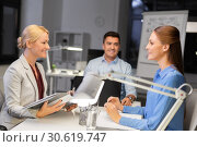Купить «business team with laptop working late at office», фото № 30619747, снято 6 декабря 2017 г. (c) Syda Productions / Фотобанк Лори