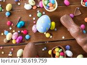 Купить «chocolate eggs, easter bunny and candies on wood», фото № 30619759, снято 22 марта 2018 г. (c) Syda Productions / Фотобанк Лори
