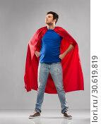 Купить «man in red superhero cape over grey background», фото № 30619819, снято 3 февраля 2019 г. (c) Syda Productions / Фотобанк Лори