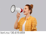 Купить «red haired teenage girl speaking to megaphone», фото № 30619859, снято 28 февраля 2019 г. (c) Syda Productions / Фотобанк Лори