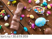 Купить «chocolate eggs, easter bunny and candies on wood», фото № 30619959, снято 22 марта 2018 г. (c) Syda Productions / Фотобанк Лори
