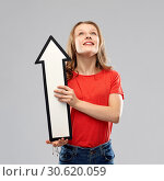 Купить «smiling teenage girl with arrow showing direction», фото № 30620059, снято 17 февраля 2019 г. (c) Syda Productions / Фотобанк Лори