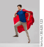 Купить «man in red superhero cape jumping in air», фото № 30620123, снято 3 февраля 2019 г. (c) Syda Productions / Фотобанк Лори